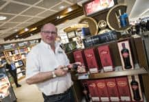Sandy McIntyre Tamdhu Distillery Manager signing bottles at Edinburgh Airport